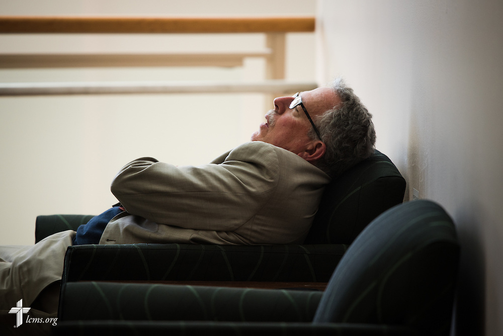 A delegate grabs a quick nap during recess on Tuesday, July 12, 2016, at the 66th Regular Convention of The Lutheran Church–Missouri Synod, in Milwaukee. LCMS/Frank Kohn