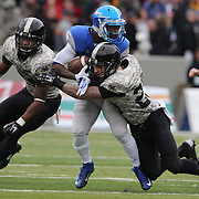 Chris Carnegie, (left), and Rhyan England, (right),  Army, assists in the tackle of Garrett Brown, Air Force, during the Army Black Knights Vs Air Force Falcons, College Football match at Michie Stadium, West Point. New York. Air Force won the game 23-6. West Point, New York, USA. 1st November 2014. Photo Tim Clayton