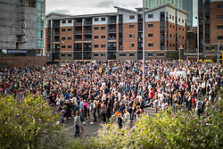 © Licensed to London News Pictures . 16/07/2017 . Manchester , UK . Crowds watch events and pre-recorded video on a big screen , in a car park opposite Home . The closing event of the Manchester International Festival at Home arts venue (formally the Cornerhouse) in Manchester City Centre , featuring dance, music, socialist workshops , all in the shadow of the newly unveiled statue of Friedrich Engels , at Tony Wilson Place . Photo credit : Joel Goodman/LNP