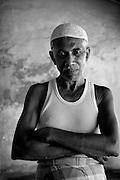 Muslim man in banian and sarong. Tamil Nadu. South India.