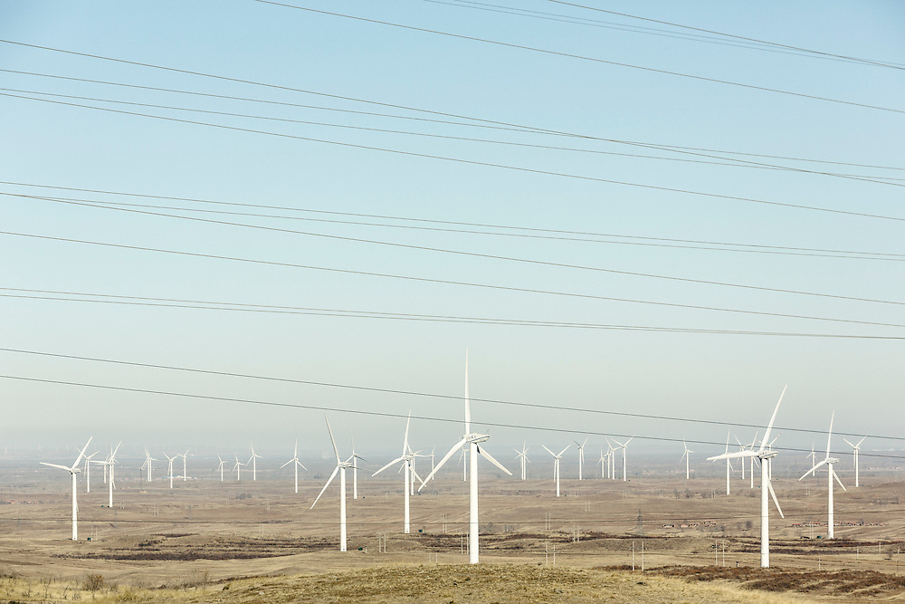 Located in Hebei Province, China this  project consists a multiitude of 1.5 MW wind turbines to supply zero-emissions renewable electricity to the North China Power Grid. With a total capacity of 49.5 MW, this wind power plant supplies the North China Power Grid with approximately 103,00 MWh of clean electricity every year. The project reduces GHG emissions by displaying electricity which would otherwise have been drawn primarily from fossil fuel power stations and results in annual emissions reductions of roughly 100,000 tCO2e. China is currently the largest producer and consumer of coal in the world and derives nearly 80% of its electricity from this fuel source. Though investment in nuclear and renewable technologies is increasing in China, investment in coal-fired power generation still ranks first and continues to grow. Wind power in particular only amounts to less than three percent of the national electricity output.