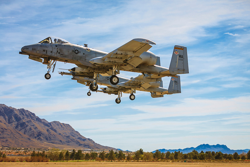 "A-10 ""Warthogs"" on final approach at Nellis Air Force Base, near Las Vegas, Nevada.  Created during a ""Red Flag"" exercise.  Created by aviation photographer John Slemp of Aerographs Aviation Photography. Clients include Goodyear Aviation Tires, Phillips 66 Aviation Fuels, Smithsonian Air & Space magazine, and The Lindbergh Foundation.  Specialising in high end commercial aviation photography and the supply of aviation stock photography for commercial and marketing use."