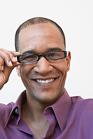 Man Adjusting His Eyeglasses