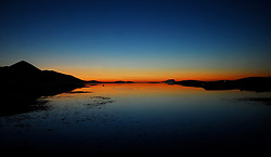 Winter twilight looking out over Clew Bay, With the Reek in silloutte..Photograph by Conor McKeown..Prints available various sizes.