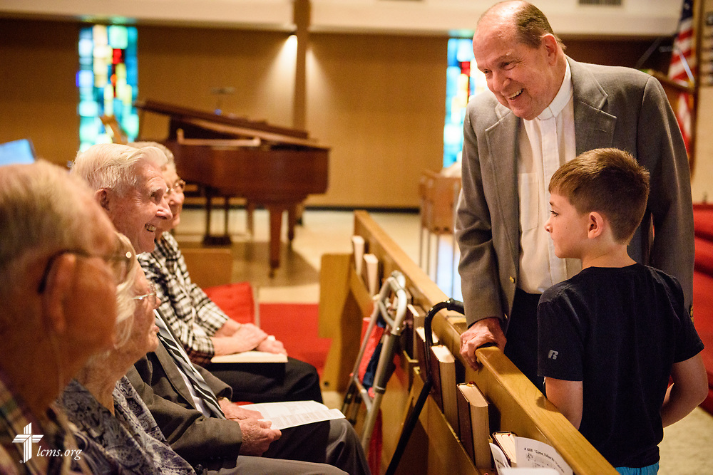 The Rev. Bill Qualman, pastor at Mt. Calvary Lutheran Church, La Grange, Texas, and his grandson Gabs greet church members before Divine Service at the church on Sunday, Sept. 3, 2017. Last week, only a handful of church members who weren't trapped by the floodwaters made it to worship. A week after Hurricane Harvey the pews filled up again after the waters receded. LCMS Communications/Erik M. Lunsford