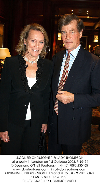 LT.COL.SIR CHRISTOPHER & LADY THOMPSON  at a party in London on 1st October 2003.PNG 54