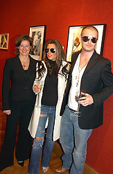 Left to right, photographer ALISON JACKSON with David & Victoria Beckham lookalikes at an aution of art inspired by footballer David Beckham in aid of The National Deaf Children's Society and held at Christie's, St.James's, London on 4th November 2004.<br /><br />NON EXCLUSIVE - WORLD RIGHTS