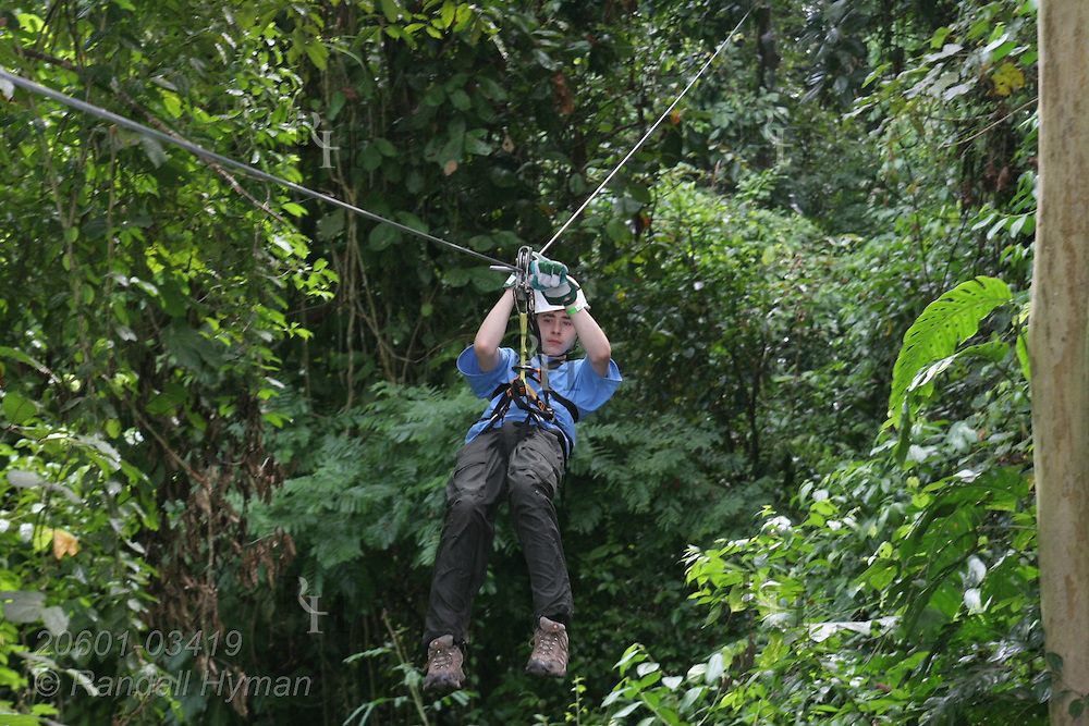 Ecoteach teen Luke Young (age 16) ziplines through Pacific coastal rainforest on the Monkey Trail Canopy Tour at Hotel Punta Leona, Costa Rica.