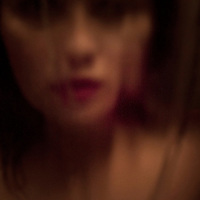 The blurred image of a woman's face