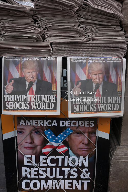 """London, 9th November 2016: US president-elect, Donald Trump appears on the front page of the London Evening Standard newspaper at Oxford Circus, London, on the day of his election. The headline reads """"Trump Triumph Shocks World"""" and Londoners of all colours and races take the free paper to read the latest overnight news. © Richard Baker / Alamy Live News"""