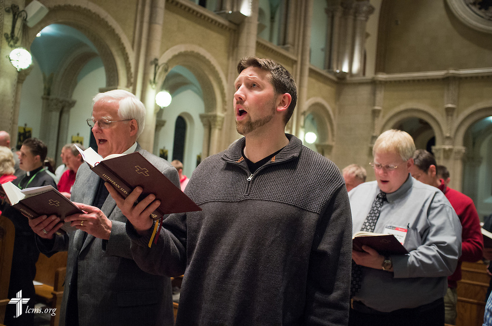 The Rev. Dr. Lucas Woodford sings during evening prayer at the DOXOLOGY Encore event on Friday, Feb. 21, 2014, in Springfield, Ill. Next to Woodford on the left is the Rev. Dr. Harold Senkbeil, executive director for spiritual care. LCMS Communications/Erik M. Lunsford