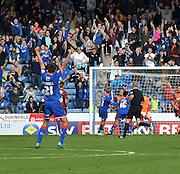 The oldham fans errupt as oldham claw one back during the Sky Bet League 1 match between Oldham Athletic and Bradford City at Boundary Park, Oldham, England on 5 September 2015. Photo by Mark Pollitt.