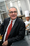 Alain Ducasse talks in the kitchen of Beige Alain Ducasse Tokyo in the Ginza district of Tokyo, Japan on June 3 2008. .Photographer: Robert Gilhooly.