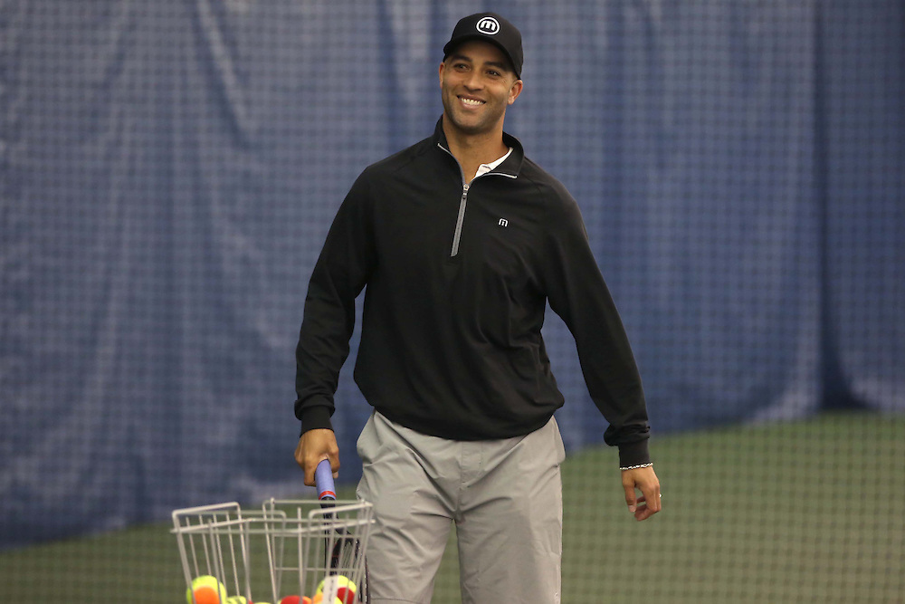 May 15, 2014, New Haven, Connecticut:<br /> Former professional tennis player James Blake runs a drill during a free tennis lesson and clinic Thursday, May 15, 2014 in advance of the 2014 New Haven Open at the Yale University Tennis Center in New Haven, Connecticut. <br /> (Photo by Billie Weiss/New Haven Open)