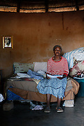 Francina reads the eviction letter she has received.  Mother &amp; Daughter Francina and Selina Netshakhuma have lived and worked on a farm near Musina for several years. When the farm was sold the new owner no longer required their services and threatened them with eviction without giving them an alternative place to go. The Legal Resources Centre has assisted them with legal advice and prevented them from becoming homeless. This case illustrates the vulnerability of rural farm workers who have no security of tenure. Near Musina, Limpopo, South Africa.<br /> <br /> <br /> Photograph by Zute Lightfoot