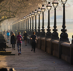 London, February 24th 2016. Runners and commuters make their way along Cheyne Walk in Chelsea as the sun rises on a chilly but clear morning in London. ©Paul Davey<br /> FOR LICENCING CONTACT: Paul Davey +44 (0) 7966 016 296 paul@pauldaveycreative.co.uk