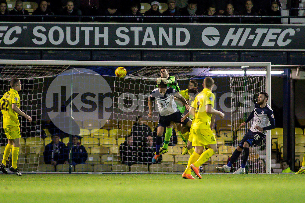 Jon McLaughlin of Burton Albion punches clear during the Sky Bet League 2 match between Southend United and Burton Albion at Roots Hall, Southend, England on 19 December 2014. Photo by Liam McAvoy.