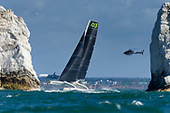 Lloyd Thornburg's Team Phaedo 3 passes The Needles lighthouse during the Round the Island Race. Isle of Wight.<br /> Picture date: Saturday July 2, 2016.<br /> Photograph by Christopher Ison &copy;<br /> 07544044177<br /> chris@christopherison.com<br /> www.christopherison.com