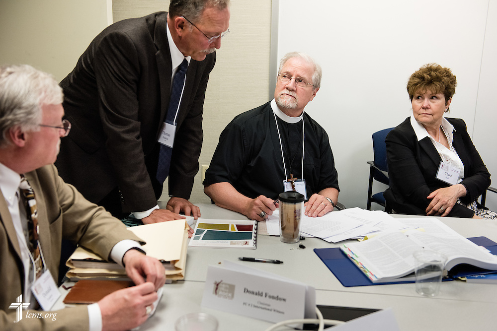The Rev. John Fale, executive director of LCMS Office of International Mission (center, right), listens to attorney Thomas Deadrick of the Commission on Constitutional Matters as the Rev. Donald Fondow, president of the LCMS Minnesota North District (left) and Clara Ball listen during floor-committee weekend at the International Center of The Lutheran Church–Missouri Synod on Saturday, May 28, 2016, in Kirkwood, Mo. LCMS Communications/Erik M. Lunsford