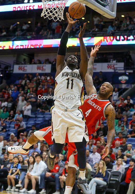 Mar 17, 2018; New Orleans, LA, USA; New Orleans Pelicans guard Jrue Holiday (11) shoots and draws the foul against Houston Rockets forward PJ Tucker (4) during the second half at the Smoothie King Center. The Rockets defeated the Pelicans 107-101. Mandatory Credit: Derick E. Hingle-USA TODAY Sports