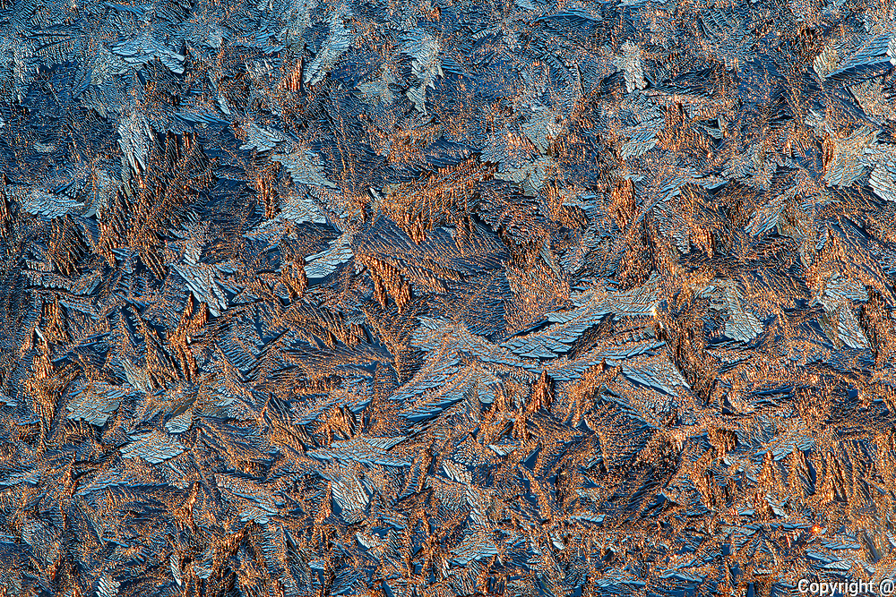 Ice patterns on window at sunrise<br />