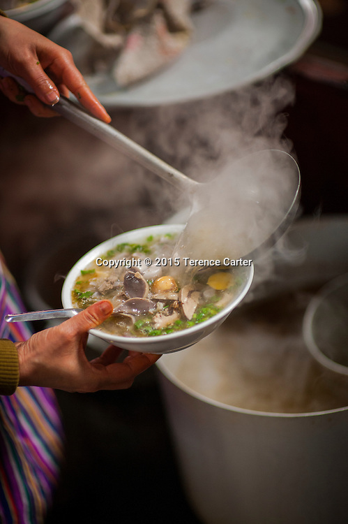 A vendor prepares a soup in the markets of Sapa, Vietnam.