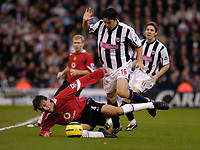 Fotball<br /> Premier League England 2004/2005<br /> Foto: SBI/Digitalsport<br /> NORWAY ONLY<br /> <br /> 27/11/2004 <br /> West Bromwich Albion v Manchester United<br /> FA Barclays Premiership, The Hawthorns<br /> <br /> Manchester United's Gabriel Heinze (L) is brought down by Cosmin Contra