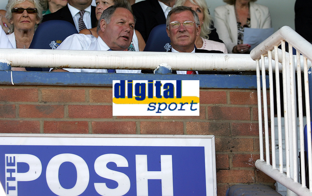 Photo: Paul Thomas.<br />Peterborough United v Manchester United. Pre Season Friendly. 04/08/2007.<br /><br />Sir Alex Ferguson (R), manager of Utd sits in the stands.