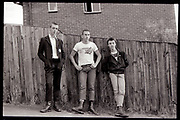 Gavin and Lorp Leaning on Fence, High Wycombe, UK. 1980s.