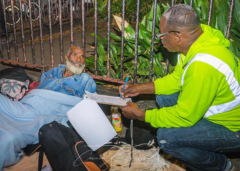 UNITY outreach worker Clarence White, right, tries to determine how much assistance James Watson will need, Nov. 11, 2015, in New Orleans, Louisiana. Watson, 57, has been homeless for 10 years and was found sleeping at Washington Square. UNITY, a 60-agency coalition, provides housing and services for people who are homeless. (Photo by Carmen K. Sisson/Cloudybright)