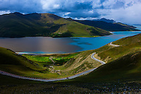 45 mile long Yamdrok Tso Lake (14,570 feet) is the largest lake and one of the three sacred lakes in Tibet (Xizang), China.