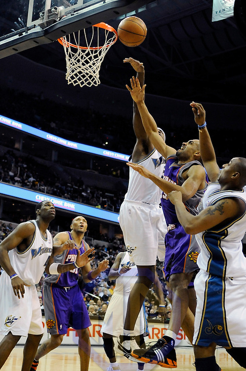 07 December 2007:   Washington Wizards center Brendan Haywood (33) blocks a shot by Phoenix Suns forward Grant Hill (33) in the second half at the Verizon Center in Washington, D.C.  The Suns defeated the Wizards 122-107.