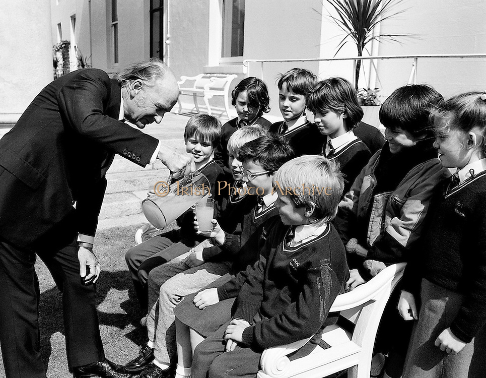 Pupils from Scoil Barra, Ballincollig, Cork, on a tour of Áras an Uachtaráin, were lucky enough to have the highlights of the Áras pointed out by the president himself, Dr Hillery.<br /> 15 June 1987