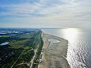 Nederland, Zuid-Holland, Gemeente Westland, 14-09-2019; Delflandse Kust ter hoogte van Ter Heijde en Monster, Maasvlakte en Tweede Maasvlakte (MV2) aan de horizon. De Zandmotor is een kunstmatig schiereiland (landtong), ontstaan door het opspuiten van zand voor de kust. Wind, golven en stroming zullen het zand langs de kust in noordelijke richting verspreiden waardoor verderop langs de kust bredere stranden en duinen ontstaan. De zandmotor is een experiment in het kader van kustonderhoud en kustverdediging.<br /> Sand Engine, artificial peninsula build by the raising of sand for the coast (near the Hague). Wind, waves and currents will distribute the sand along the coast yielding wider beaches and dunes along the coastline. The Sand Engine is a experiment for coastal maintenance of coastal defense.<br /> luchtfoto (toeslag op standard tarieven);<br /> aerial photo (additional fee required);<br /> copyright foto/photo Siebe Swart
