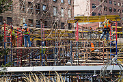 American builders work on a balance on scaffolding working on a building site in Chelsea, New York City; New York, United States of America.(photo by Andrew Aitchison / In pictures via Getty Images)