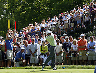 Tiger Woods of the US hits his tee shot on the sixth hole during the first day of the US Open Golf Championship at Winged Foot Golf Club in Mamaroneck, New York Thursday, 15 June 2006.
