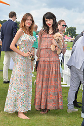 Left to right, ALEXA CHUNG and CAROLINE SIEBER and her dog Swifty at the Veuve Clicquot Gold Cup Final at Cowdray Park Polo Club, Midhurst, West Sussex on 20th July 2014.