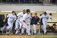 Ole Miss' Holt Perdzock (42) celebrates after scoring the winning run vs. Louisiana-Monroe at Oxford-University Stadium in Oxford, Miss. on Tuesday, February 25, 2014. Ole MIss rallied with two runs in the bottom of the 9th inning to win 5-4. (AP Photo/Oxford Eagle, Bruce Newman)