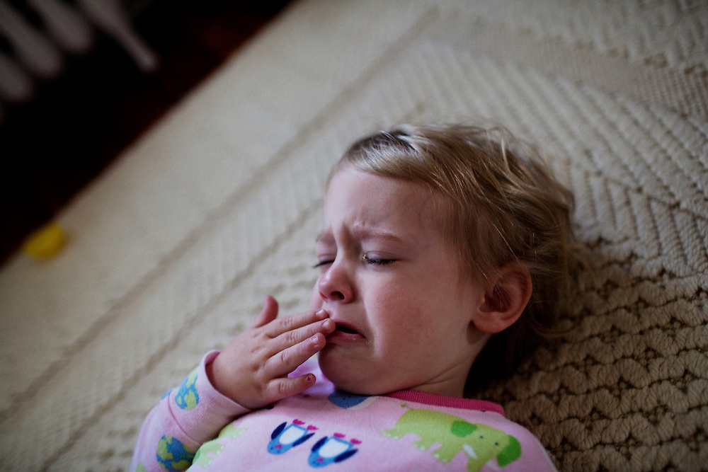 Madelyn Avery Eich, 2, cries while lying on the floor on Easter Sunday, April 4, 2010 in her home in Norfolk, Virginia.
