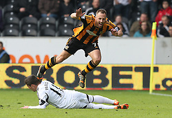 Swansea's Pablo Hernandez fouls Hull's David Meyler - Photo mandatory by-line: Matt Bunn/JMP - Tel: Mobile: 07966 386802 05/04/2014 - SPORT - FOOTBALL - KC Stadium - Hull - Hull City v Swansea City- Barclays Premiership