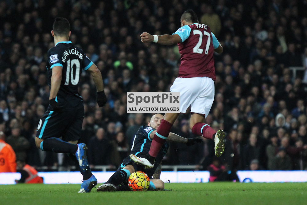 Nicolas Otamendi of Manchester City challenges Dimitri Payet for the ball during the Barclays Premier League game against West Ham United. (c) Joshua Smith | SportPix.org.uk