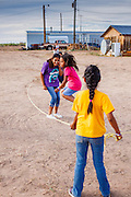 "12 JULY 2012 - FT DEFIANCE, AZ: Girls jump rope at the 23rd annual Navajo Nation Camp Meeting in Ft. Defiance, north of Window Rock, AZ, on the Navajo reservation. Preachers from across the Navajo Nation, and the western US, come to Navajo Nation Camp Meeting to preach an evangelical form of Christianity. Evangelical Christians make up a growing part of the reservation - there are now more than a hundred camp meetings and tent revivals on the reservation every year. The camp meeting in Ft. Defiance draws nearly 200 people each night of its six day run. Many of the attendees convert to evangelical Christianity from traditional Navajo beliefs, Catholicism or Mormonism. ""Camp meetings"" are a form of Protestant Christian religious services originating in Britain and once common in rural parts of the United States. People would travel a great distance to a particular site to camp out, listen to itinerant preachers, and pray. This suited the rural life, before cars and highways were common, because rural areas often lacked traditional churches.  PHOTO BY JACK KURTZ"