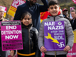 Edinburgh, Scotland, UK. 23 March, 2019. March to the Scottish Parliament in Edinburgh by far-right Scottish Defence League (SDL) was met by a counter demonstration by several left wing groups such as Unite Against Fascism, Muslin Women's Association and Edinburgh Antifa. A heavy police presence was in force and the SDL were closely escorted to and from Waverley Station. Pictured; counter demonstration by anti racist protestors