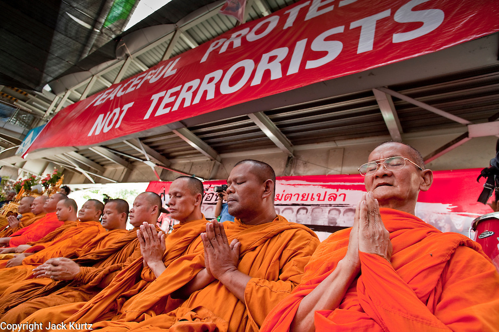 """10 MAY 2010 - BANGKOK, THAILAND: Buddhist monks lead a special memorial service for people killed in political street violence in Bangkok on April 10. The Red Shirts held a special memorial service at their main protest site in Ratchaprasong Intersection Monday with Buddhist monks leading chants to mark the one month anniversary of the street violence on April 10 that left 25 dead and more than 800 injured. Thai media is reporting that Prime Minister Abhisit Vejjajiva has given the Red Shirts has given the Red Shirts until the end of today to either accept his """"Road Map for Reconciliation"""" and end the protest or face unspecified consequences widely thought to include a military crackdown.   Photo by Jack Kurtz / ZUMA Press"""