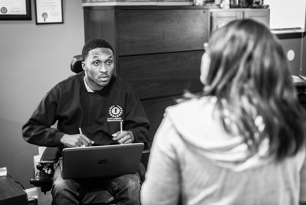 BALTIMORE, MD -- 3/2/16 -- Van Brooks runs the Safe Alternative Center, which he started to give middle school kids in West Baltimore a safe place to learn and play. <br /> <br /> Brooks was a Division 1 prospect when he played football in high school, but was paralyzed in a freak accident after making a tackle in his junior year. He regained the use of his arms, even walking again with much assistance, and graduated on time from high school. He later earned a degree in marketing from Towson University. Though still confined to a wheelchair, he is self-sufficient and runs the center.&hellip;by Andr&eacute; Chung #_AC22383