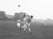 Two players jump to catch the ball as it flies over them during the Guinness v Garda Gaelic Football Club Tournament Final on the 14th October 1979.