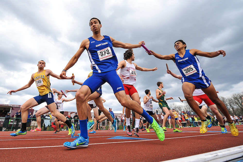 AMHERST, MA - MAY 4: Pat Sheil of St. Louis University (373) and Albert Marban of St. Louis University (365) compete in the men's 4x400 meter relay on Day 2 of the Atlantic 10 Outdoor Track and Field Championships at the University of Massachusetts Amherst Track and Field Complex on May 4, 2014 in Amherst, Massachusetts. (Photo by Daniel Petty/Atlantic 10)