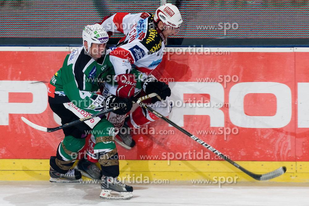 Jeff Torry (HDD Tilia Olimpija, #47) stops Johannes Reichel (EC KAC, #14) during ice-hockey match between HDD Tilia Olimpija and EC KAC in 32nd Round of EBEL league, on December 28, 2010 at Hala Tivoli, Ljubljana, Slovenia. (Photo By Matic Klansek Velej / Sportida.com)