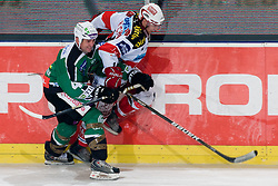 Jeff Torry (HDD Tilia Olimpija, #47) stops Johannes Reichel (EC KAC, #14) during ice-hockey match between HDD Tilia Olimpija and EC KAC in 32nd Round of EBEL league, on December 28, 2010 at Hala Tivoli, Ljubljana, Slovenia. (Photo By Matic Klansek Velej / Sportida.com)