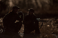 DEER HUNTERS TAKING A BREAK TO CHAT WHILE HUNTING
